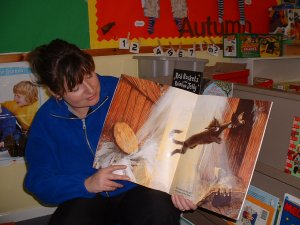 Staff member reading a story
